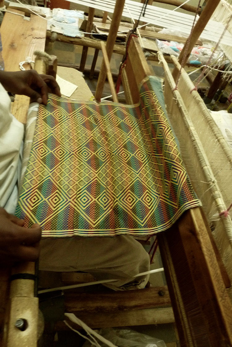 result of the weaving at the weaving table, a geometric pattern fabric
