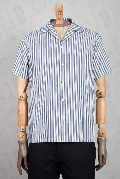 Shirt on model with off-white and blue stripes