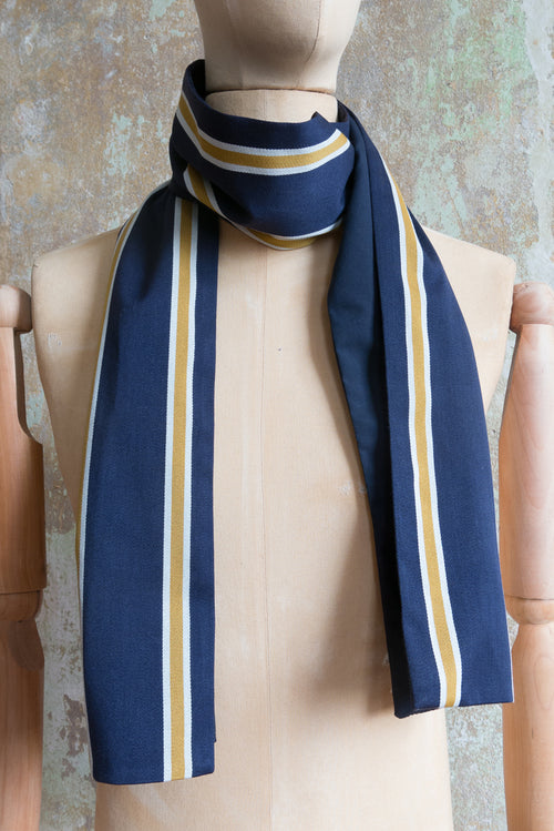 A recall on the british college scarf Navy, white, yellow vertical stripes