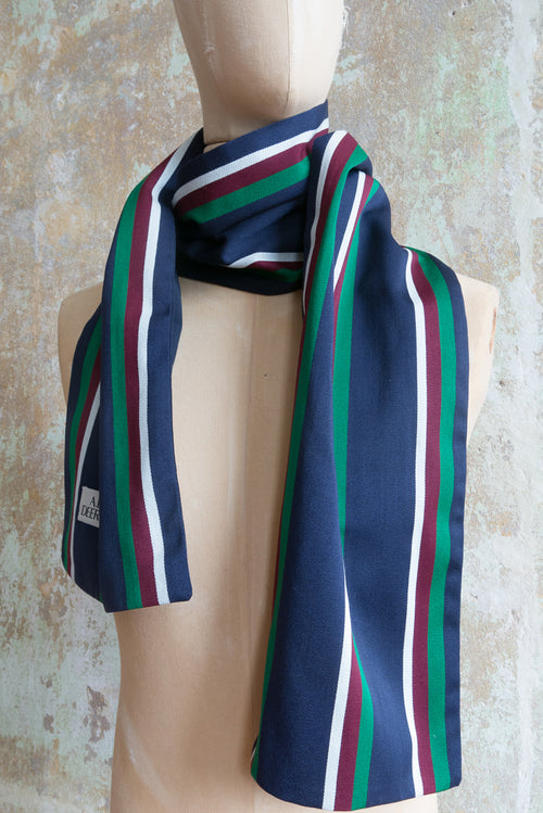 A recall on the british college scarf Navy, white, green and wine vertical stripes on one side, navy on the other