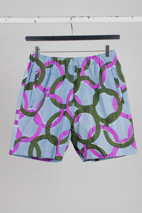 Draw string shorts in Wax-printed cotton with a all over circle pattern similar to the olimpic rings in purple and olive