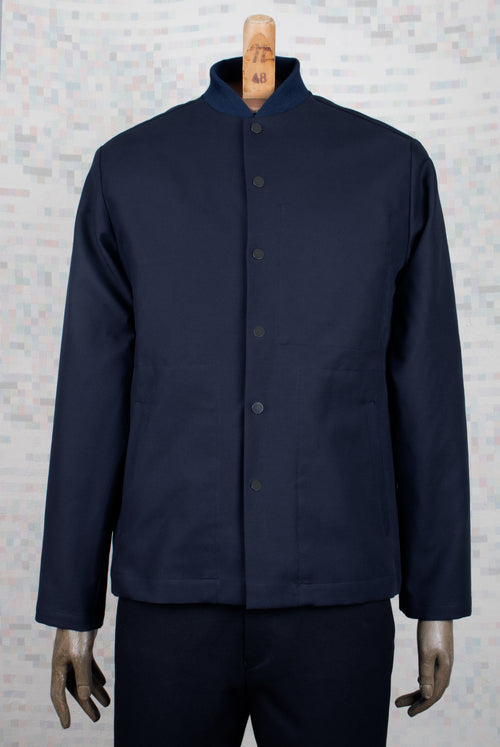 dark navy coach jacket on model closed, straight cut and 2 side pockets