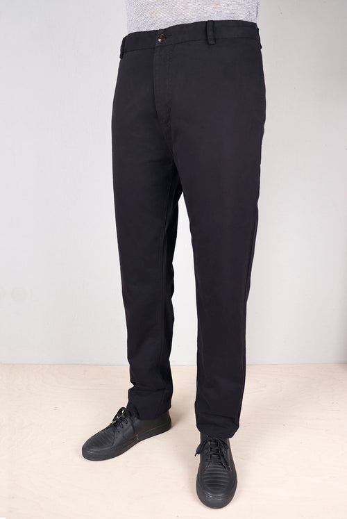 Tapered fit pants Front pockets crafted into the side seam Zip fly and corozo nut buttons Brushed black cotton twill fabric on dummy