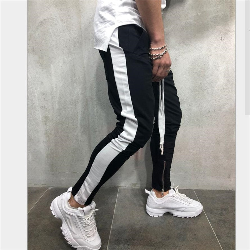 New men's fitness brand stitching sweatpants men's bodybuilding elastic with solid color trousers fashion pencil pants M-XXXL-geekbuyig