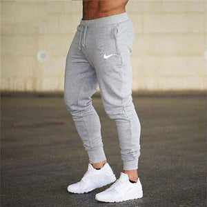 New Brand Print logo Gyms Men Joggers Casual Men Sweatpants Joggers Pantalon Homme Trousers Sporting Clothing Bodybuilding Pants