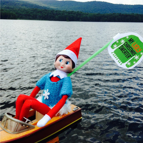 Christmas in July boating elf with a Christmas sweater. See more #elfontheshelf in #christmassweaters at www.myuglychristmassweater.com