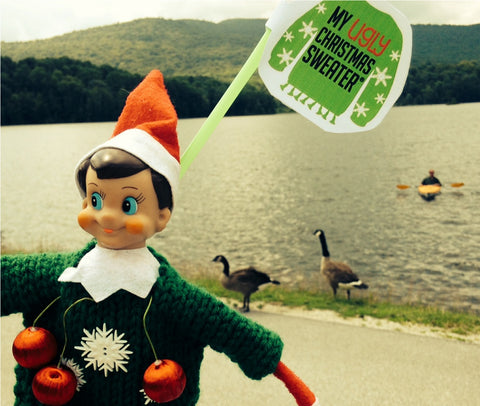 Elf with green sweater with ducks celebrating Christmas in July. See more #elfontheshelf in #christmassweaters at www.myuglychristmassweater.com