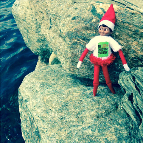 Elf cliff jumping at the Christmas in July Party. See more #elfontheshelf in #christmassweaters at www.myuglychristmassweater.com
