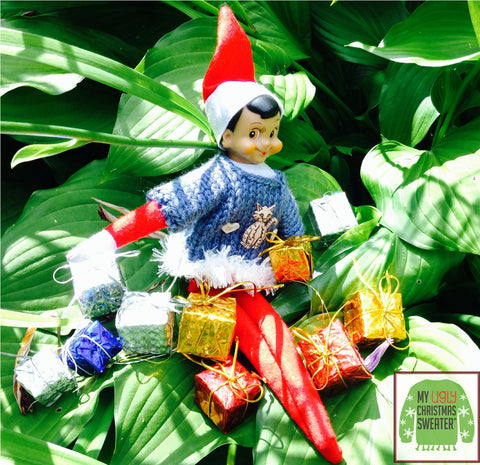 Elf at a Christmas in July party in the garden.  See more #elfontheshelf in #christmassweaters at www.myuglychristmassweater.com