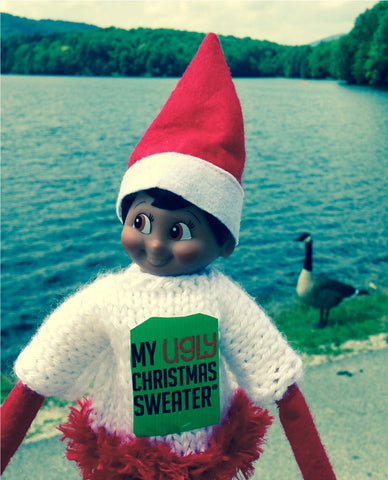 Elf with duck at the lake wearing a Christmas sweater. See more #elfontheshelf in #christmassweaters at www.myuglychristmassweater.com