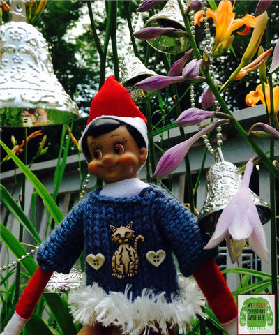 Elf with festive plants at a Christmas in July party. See more #elfontheshelf in #christmassweaters at www.myuglychristmassweater.com
