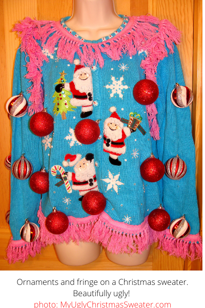 adorable blue christmas sweater with pink fringe and ornament balls