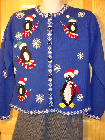 Tacky Ugly Christmas Sweater with a Blue Winter Wonderland of Penguins Sledding on Candy Canes (f466)