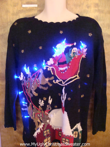 Santa and Reindeer Landing on a House Light Up Ugly Xmas Sweater