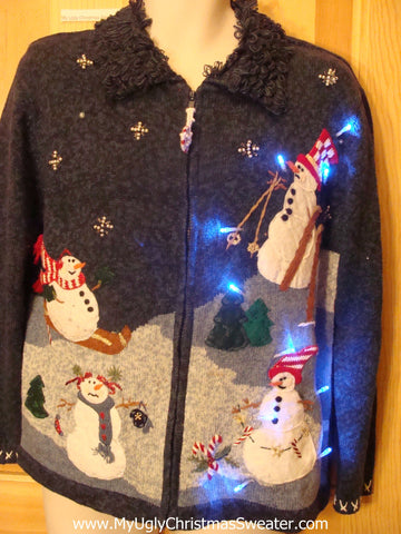 Need to Buy Christmas Sweaters? Light Up Sweater with Skiing Snowmen