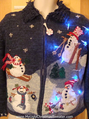 Need to Buy Christmas Sweaters? Skiing Snowmen Light Up Sweater
