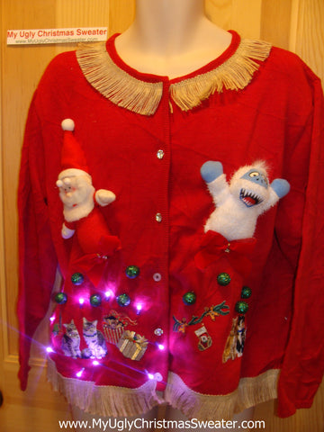 Tacky Ugly Christmas Sweater with Santa and Monster from 'Rudolph' with Lights and Fringe (g77)