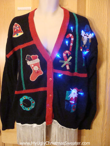 Tacky Light Up Christmas Sweater Nutcracker Toy Candycane Fringe
