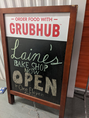 A-frame black marker board sign with GrubHub ad