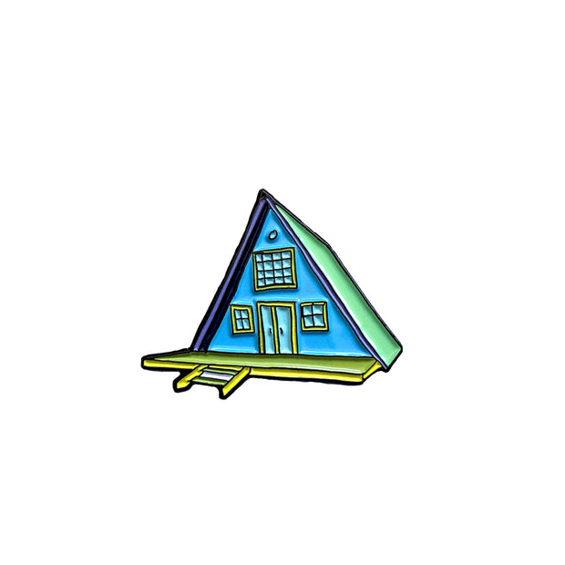 Camping pin in the shape of an a-frame cabin