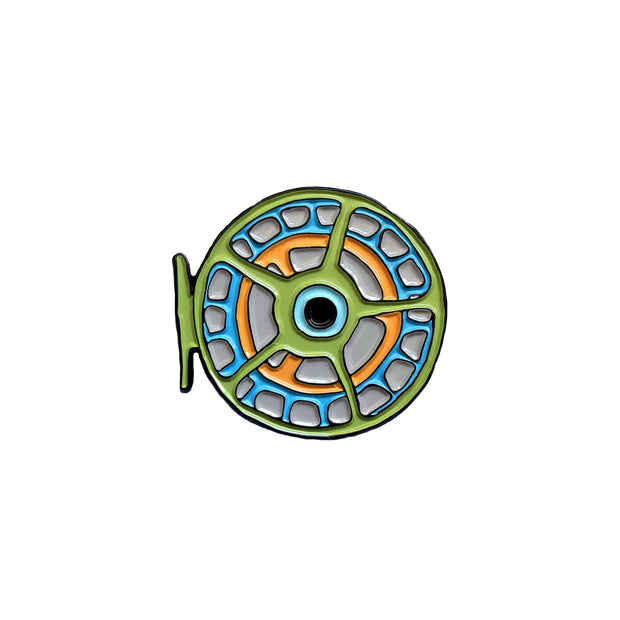 Enamel pin in the shape of a fish reel