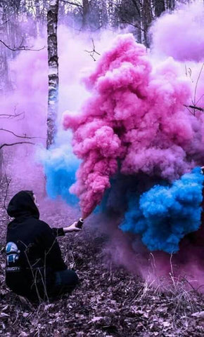 blue and pink colored smoke bomb photography