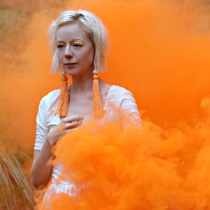 Orange smoke bombs photography