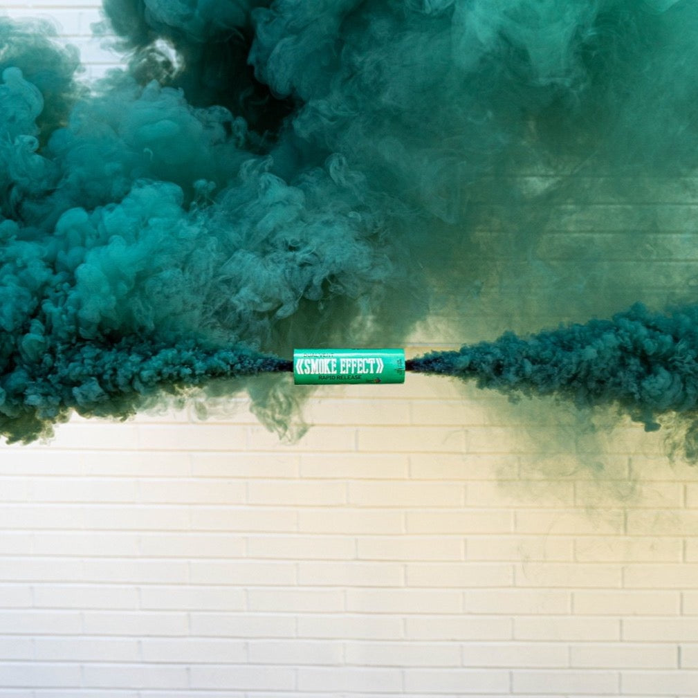 Teal blue colored smoke wedding smoke bomb