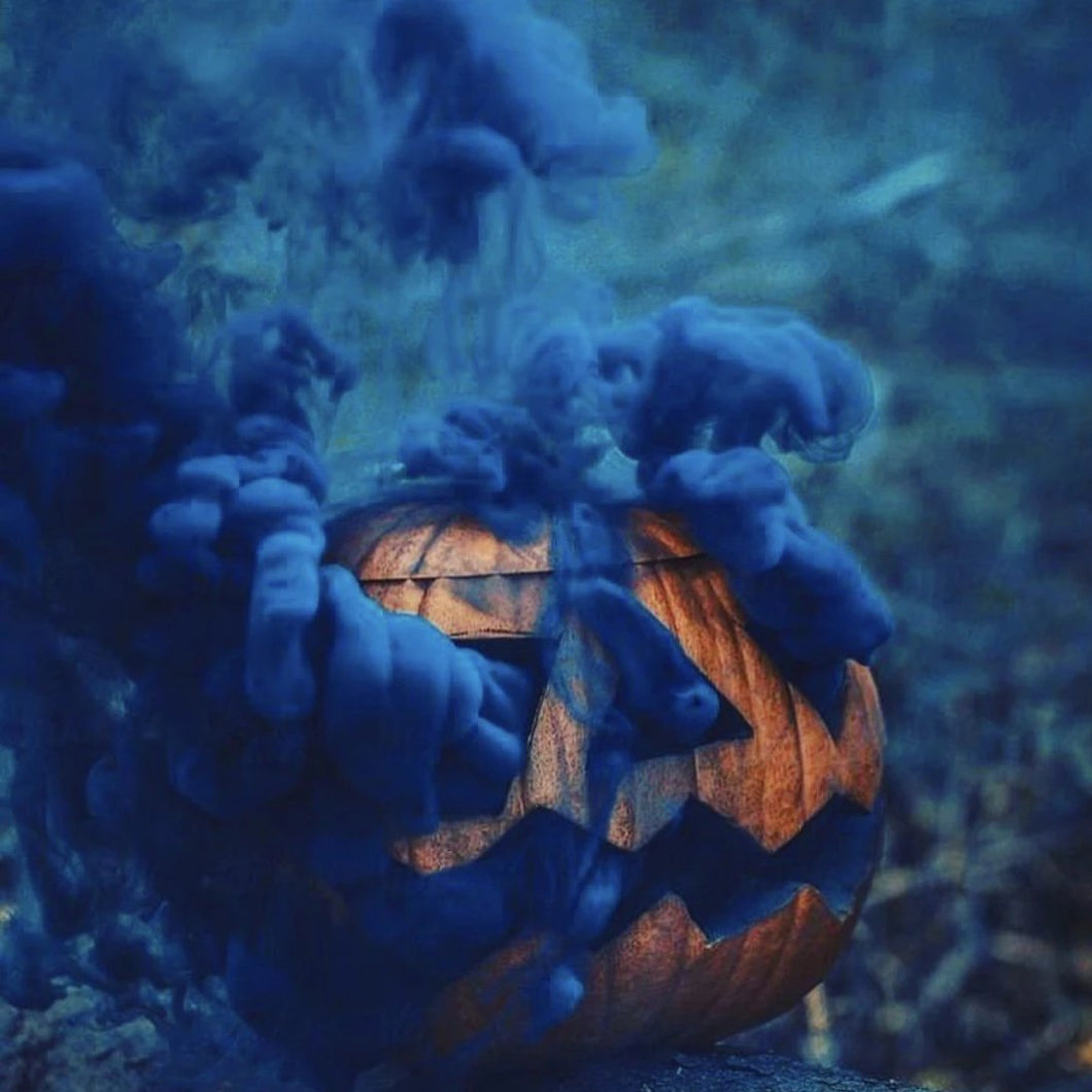 blue smoke bomb in pumpkin halloween photoshoot