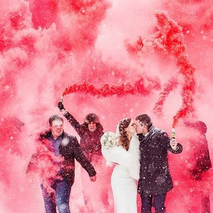 pink colored smoke bomb gender reveal wedding effect