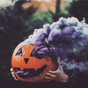 purple smoke bomb in pumpking halloween photography