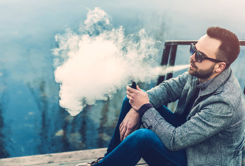 Man with beard vaping