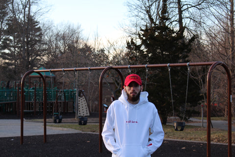 Male model wearing white self-love hoodie