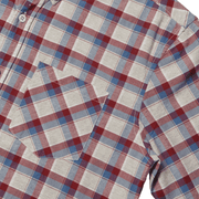 Flat lay focused on the front left chest pocket of a plaid button up shirt.