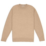 Front facing flat lay of a natural colored alpaca, raglan sleeved sweater.