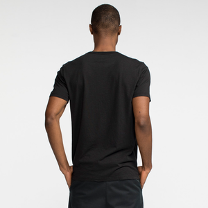 Model back facing wearing a short sleeve black tee shirt.
