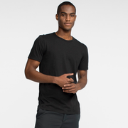 Model front facing wearing a short sleeve, black tee shirt