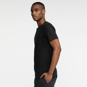 Model side facing wearing a short sleeve, black tee shirt.
