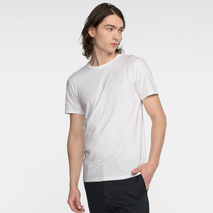 Model side facing wearing a short sleeve, white tee shirt.