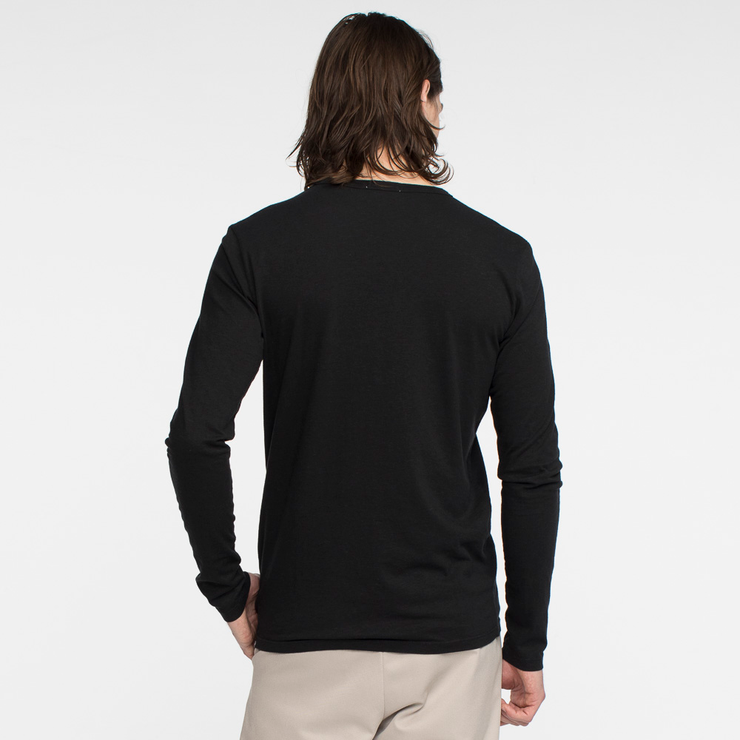 Model facing back wearing a long sleeve, black tee shirt.