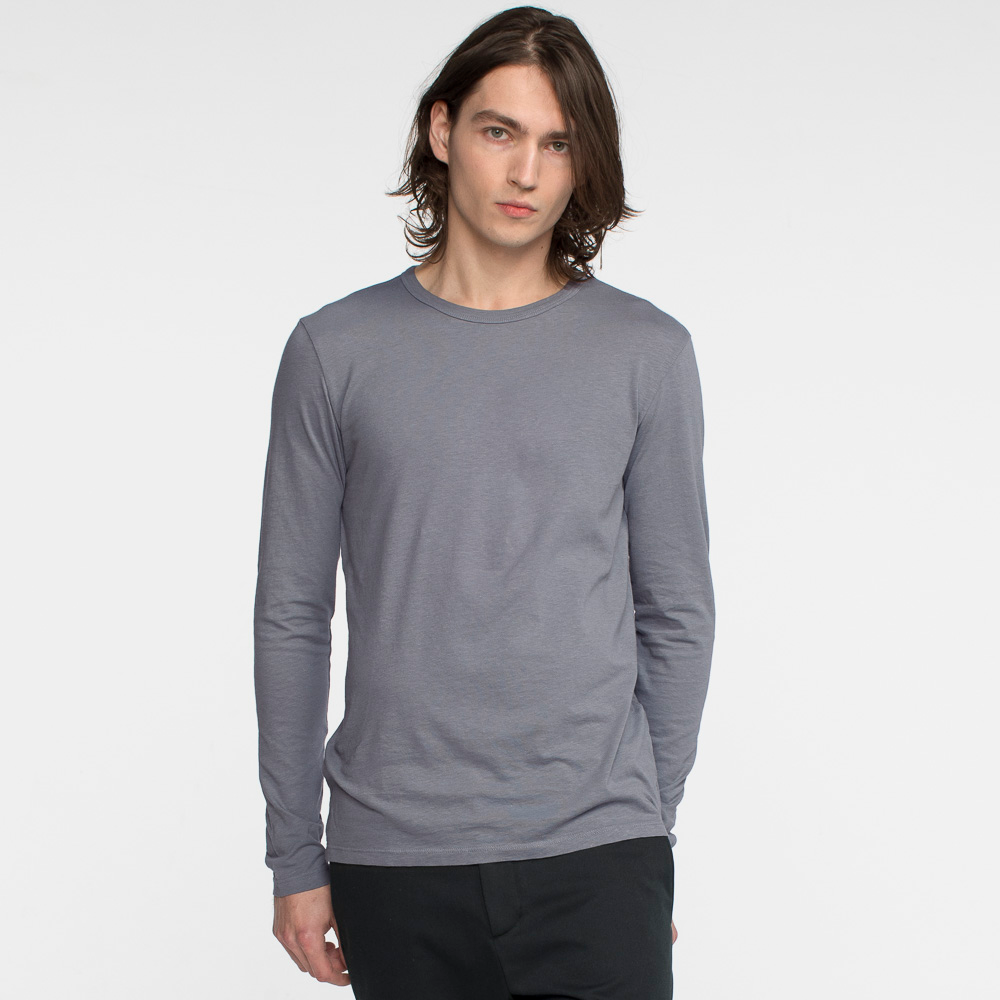 Model facing front wearing long sleeve, slate, tee shirt.