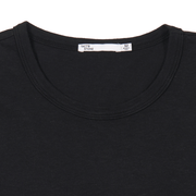 Flat lay focused on the collar of a black tee shirt. You can see Tact & Stone neck label.