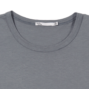 Flat lay focused on the collar of a slate tee shirt. You can see the Tact & Stone neck label.