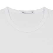 Flat lay focused on the collar of a white tee shirt. Can see the Tact & Stone neck label.