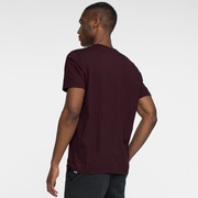 Model back facing wearing a short sleeve, burgundy tee shirt.