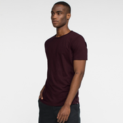 Model side facing wearing a short sleeve, burgundy tee shirt.