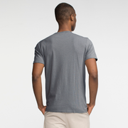 Model facing back wearing a slate, short sleeve tee shirt.