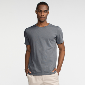Model front facing wearing a slate, short sleeve tee shirt.