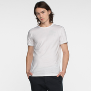 Model facing front wearing a short sleeve, white tee shirt.
