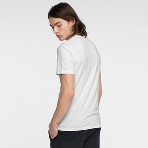 Model facing back wearing a short sleeve, white tee shirt